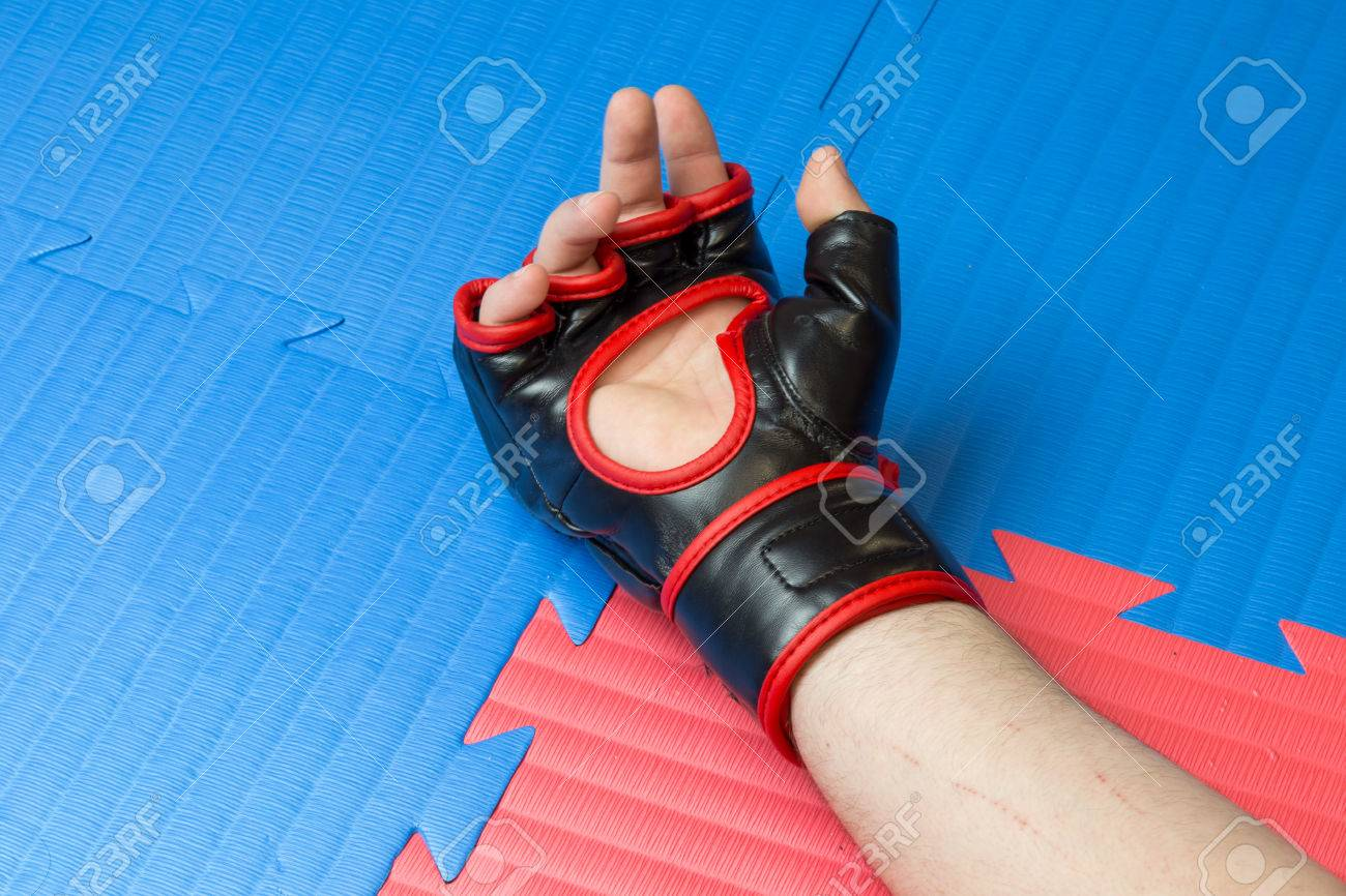 Concept of defeat, loss  Martial artist hand wearing mix mma