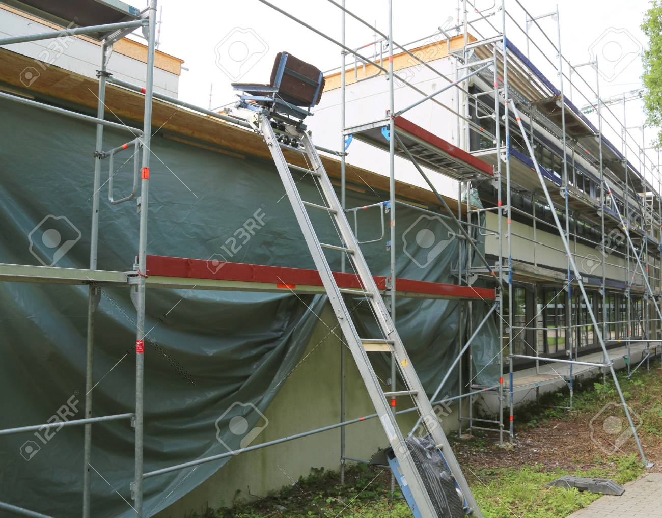 Repair Of The Building, Construction Chair Lift And Scaffolding. Stock  Photo   104612028