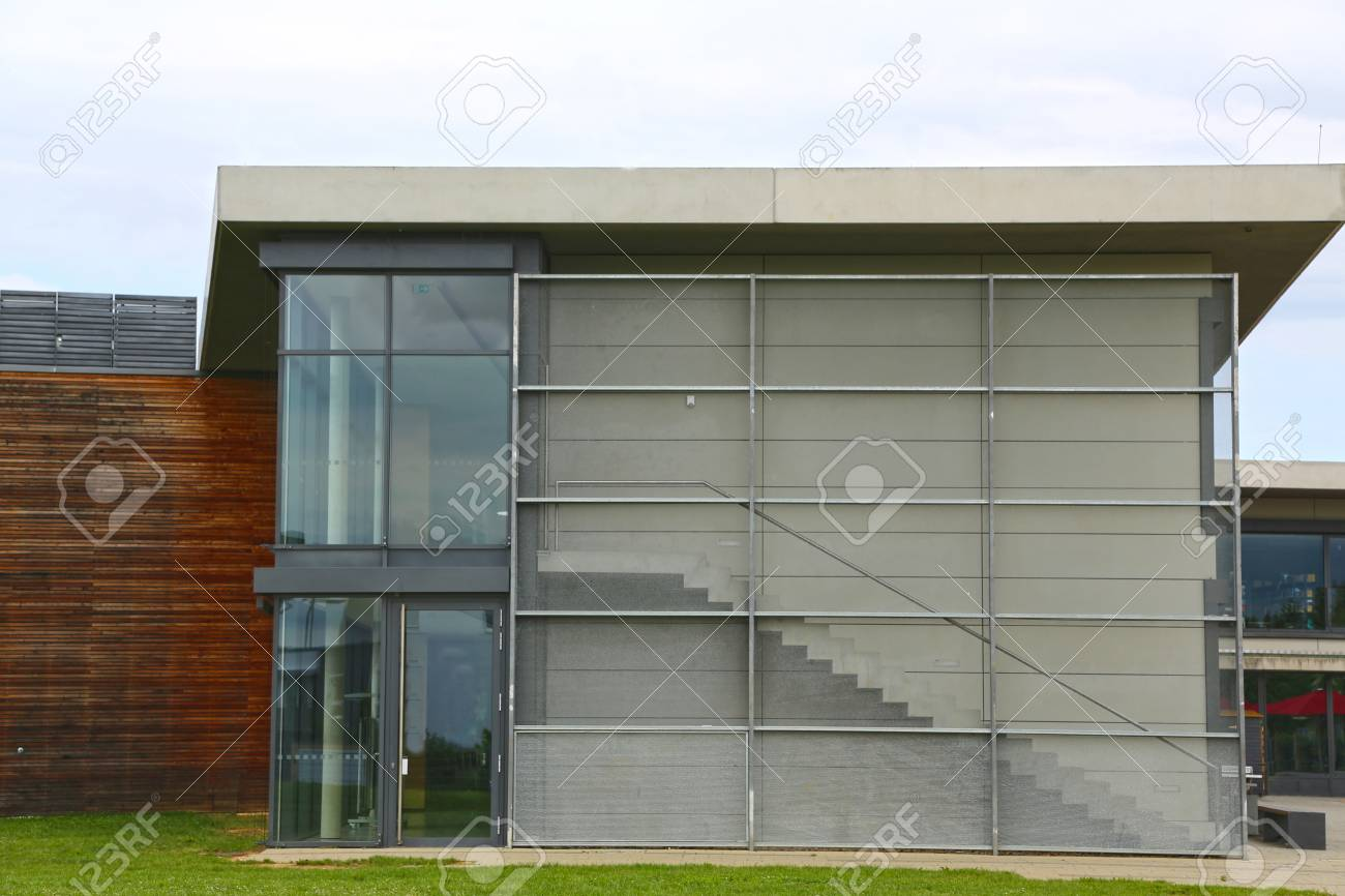 Exterior glass wall of a modern house with a door and steps stock photo