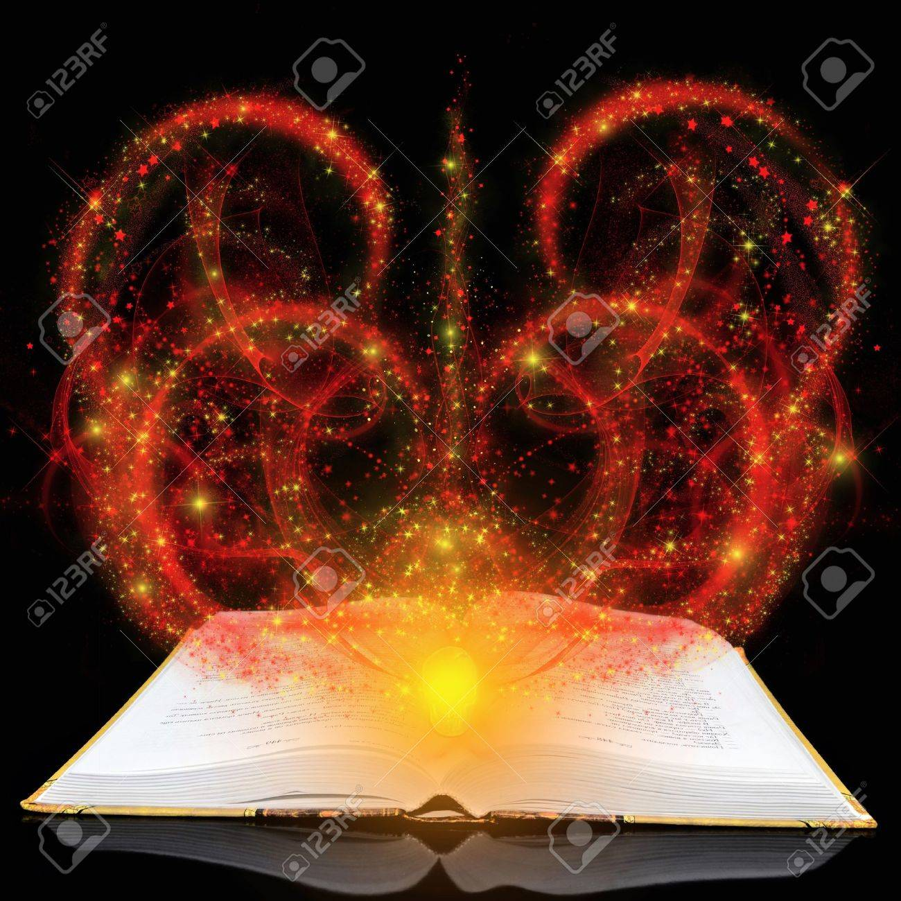 Magic book with red splashes on a black background Stock Photo - 13478991