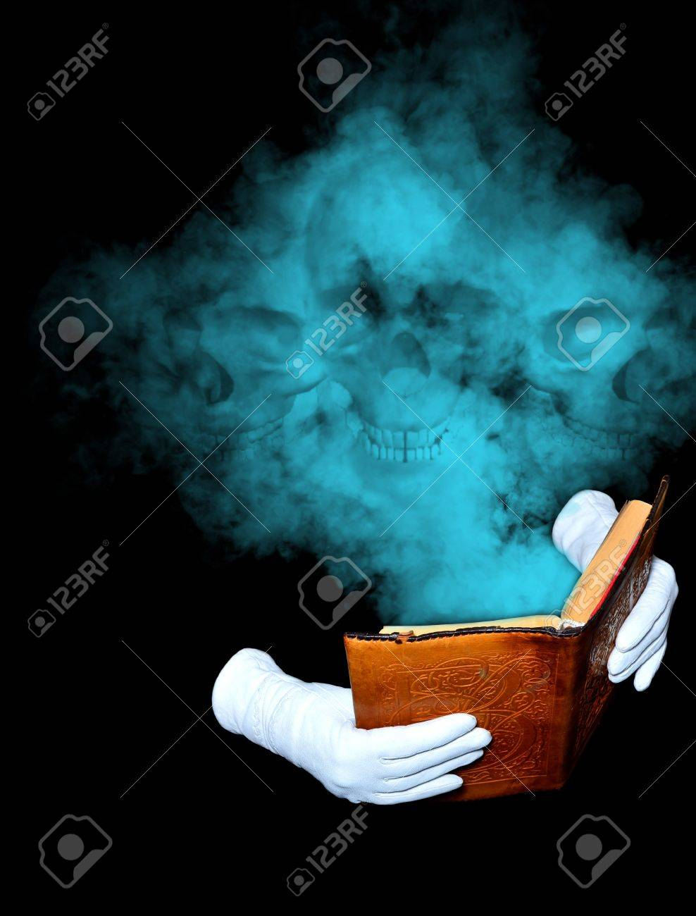 Magic book in leather-bound held by hands in white gloves Stock Photo - 13830770