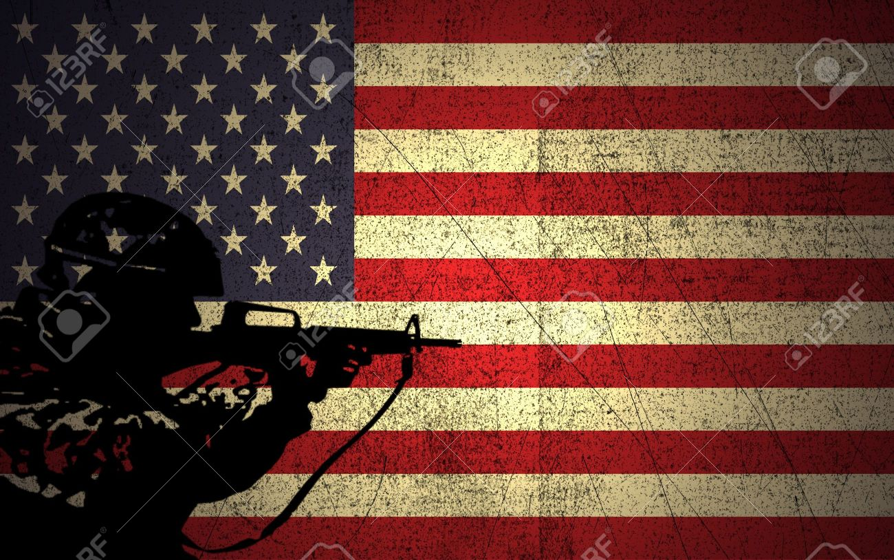 a silhouette of a soldier on the grunge american flag stock photo