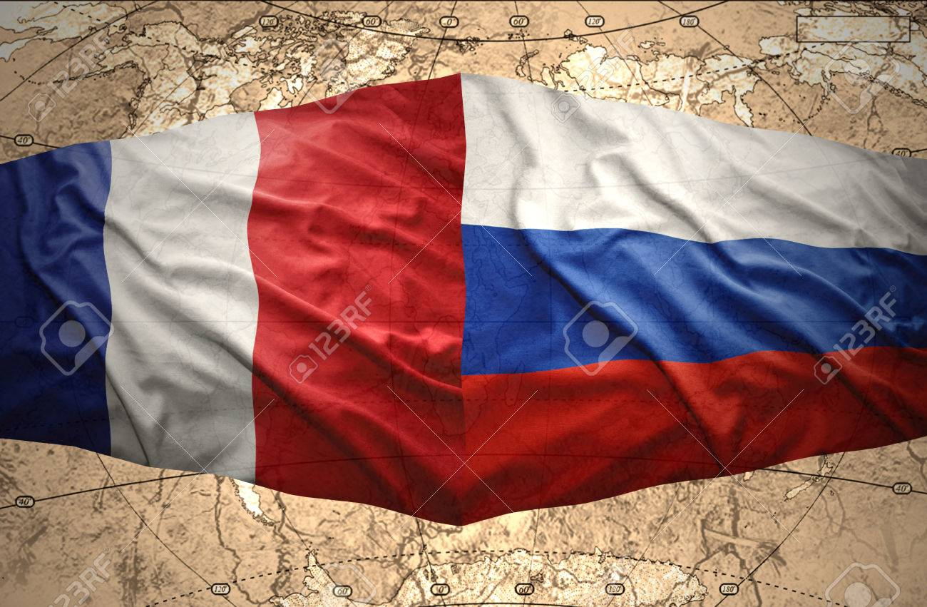 waving french and russian flags of the political map of the
