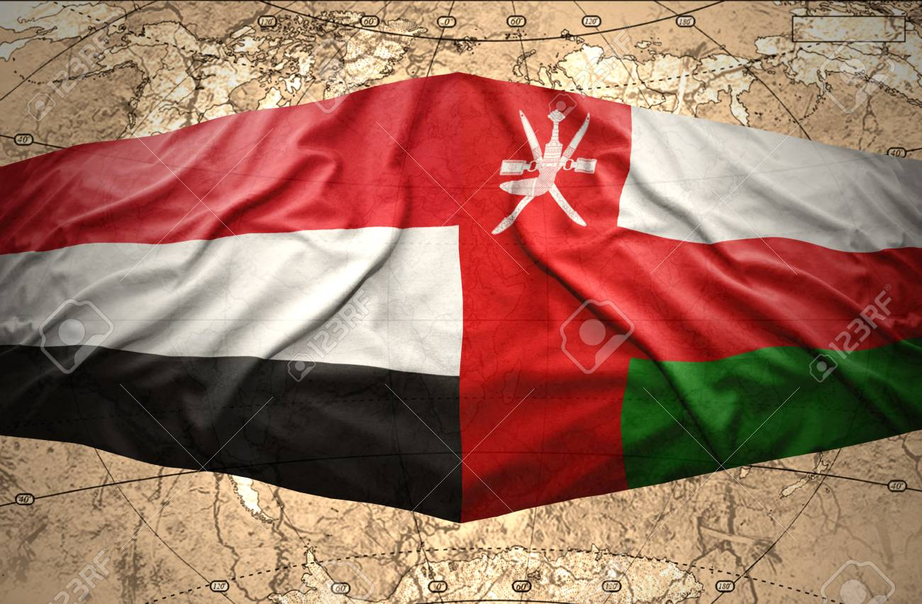 Waving Yemeni and Omani flags on the of the political map of