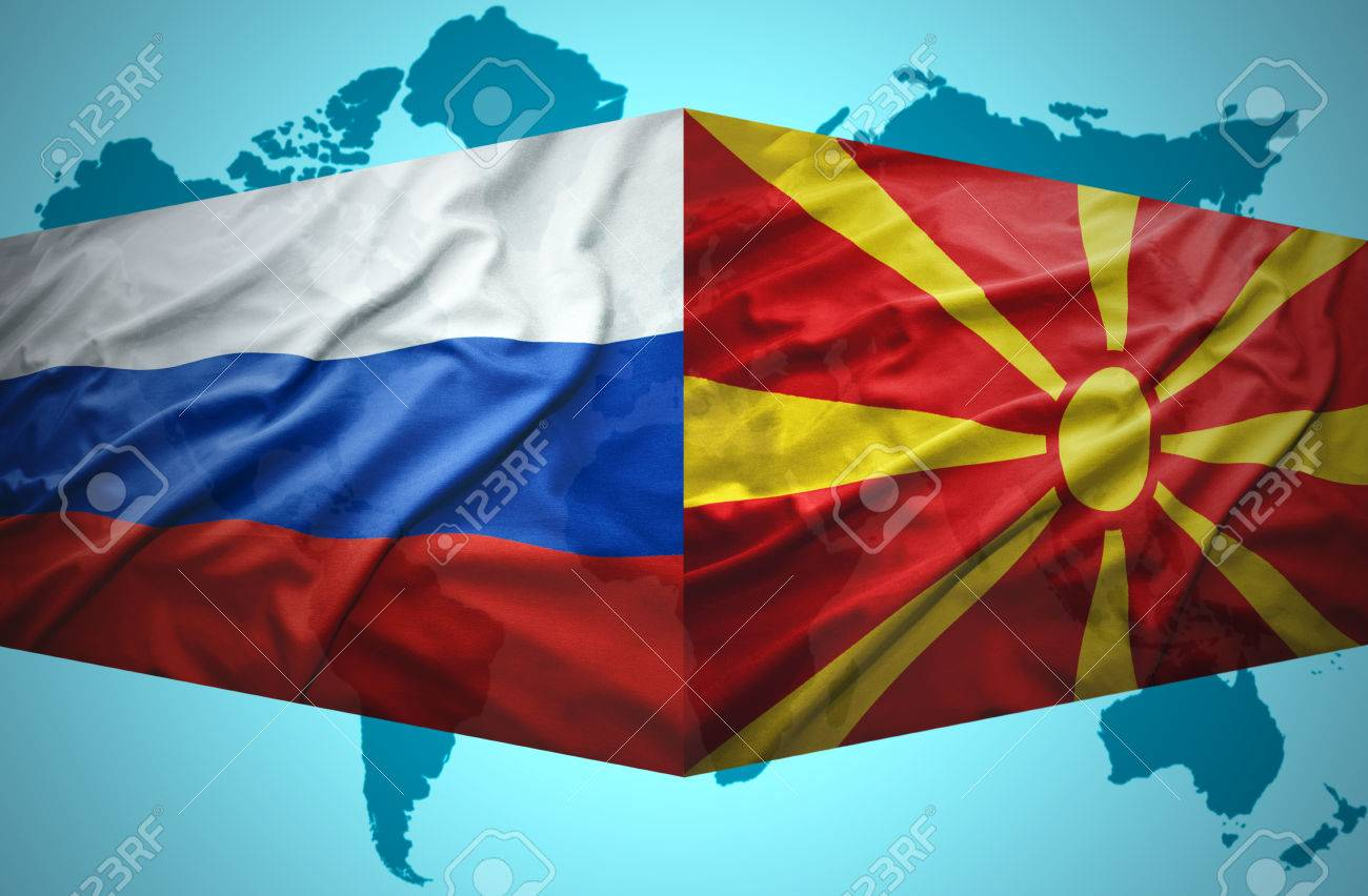 waving macedonian and russian flags of the political map of the