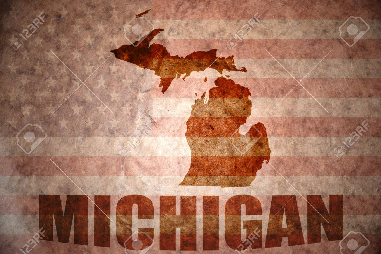 Michigan Map On A Vintage American Flag Background Stock Photo