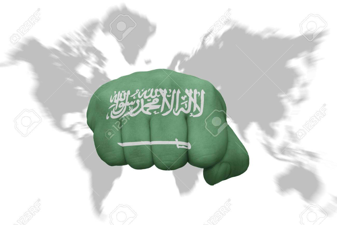 Fist With The National Flag Of Saudi Arabia On A World Map