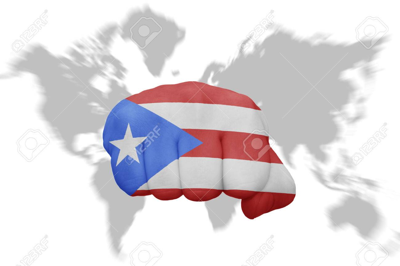 Fist With The National Flag Of Puerto Rico On A World Map Background ...