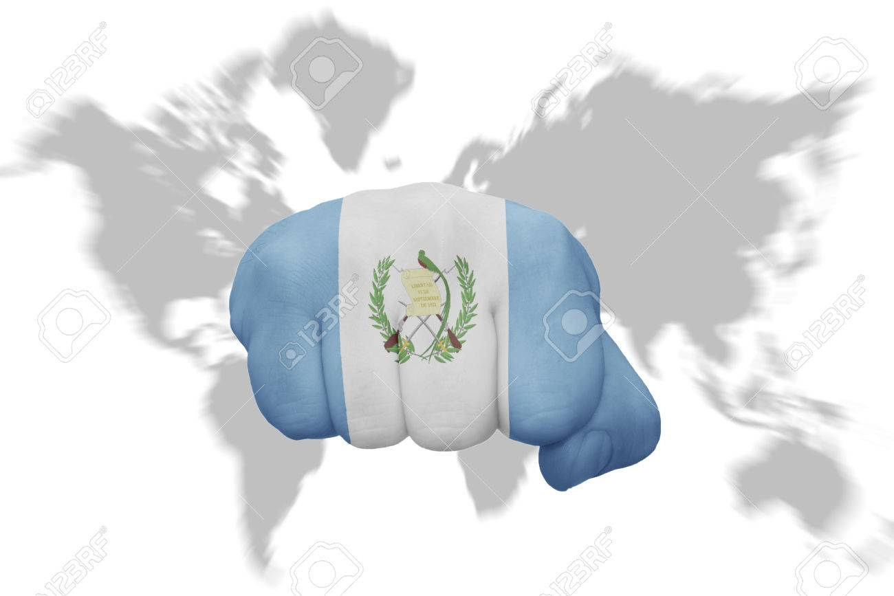 Fist With The National Flag Of Guatemala On A World Map Background