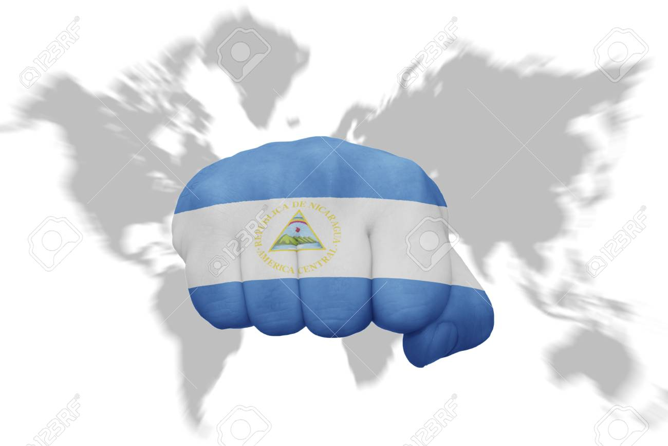 Fist With The National Flag Of Nicaragua On A World Map Background ...
