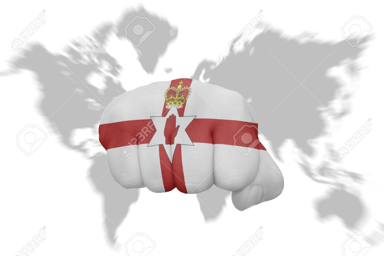 Fist with the national flag of northern ireland on a world map fist with the national flag of northern ireland on a world map background stock photo gumiabroncs
