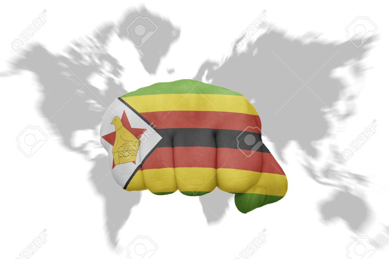 fist with the national flag of zimbabwe on a world map background Zimbabwe On A World Map on spain on world map, mali on world map, myanmar on world map, angola on world map, gabon world map, argentina on world map, siberia on world map, ghana world map, jericho on world map, great zimbabwe on world map, somalia on world map, guatemala on world map, madagascar on world map, paris world map, france on world map, java on world map, zimbabwe on a map of africa, zimbabwe on a regional map, sudan on world map, zimbabwe on african map,
