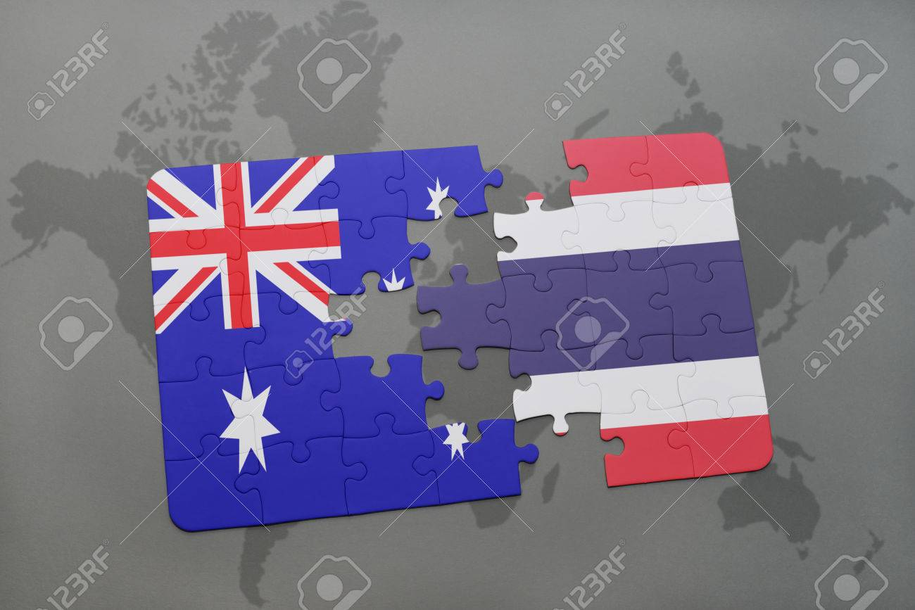 Australia Map Jigsaw.Puzzle With The National Flag Of Australia And Thailand On A Stock