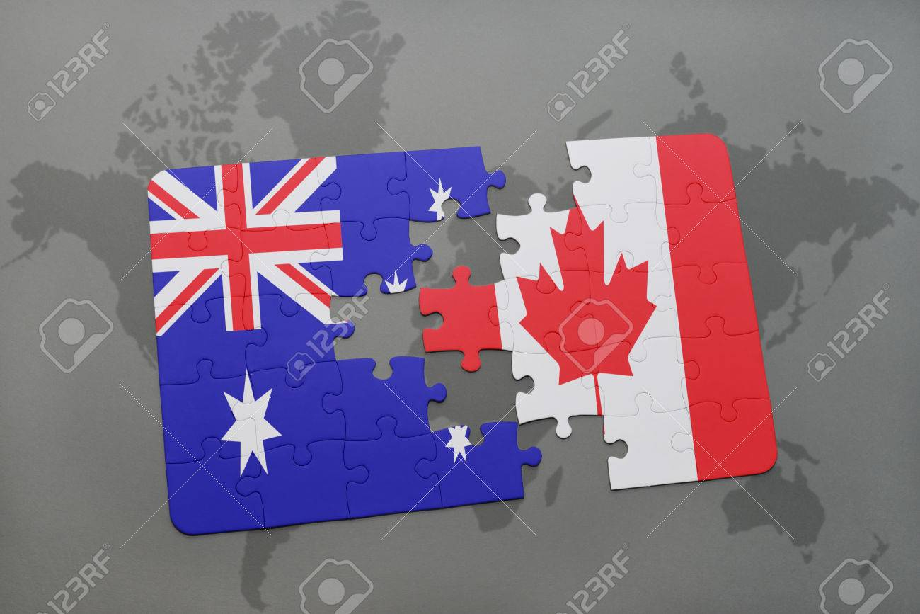 Puzzle with the national flag of australia and canada on a world illustration puzzle with the national flag of australia and canada on a world map background3d illustration gumiabroncs