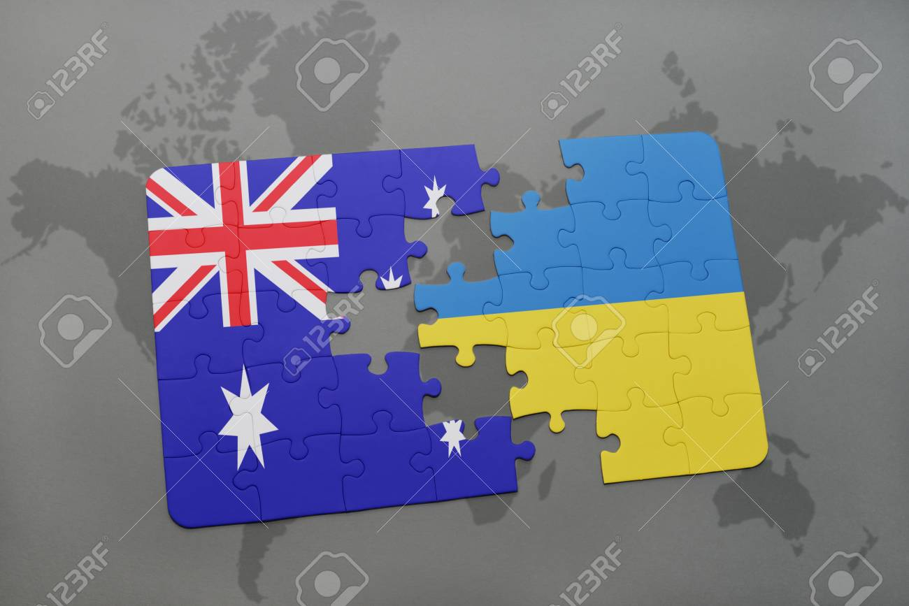 Puzzle with the national flag of australia and ukraine on a world puzzle with the national flag of australia and ukraine on a world map background stock gumiabroncs Images