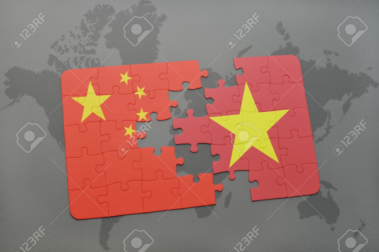 puzzle with the national flag of china and vietnam on a world