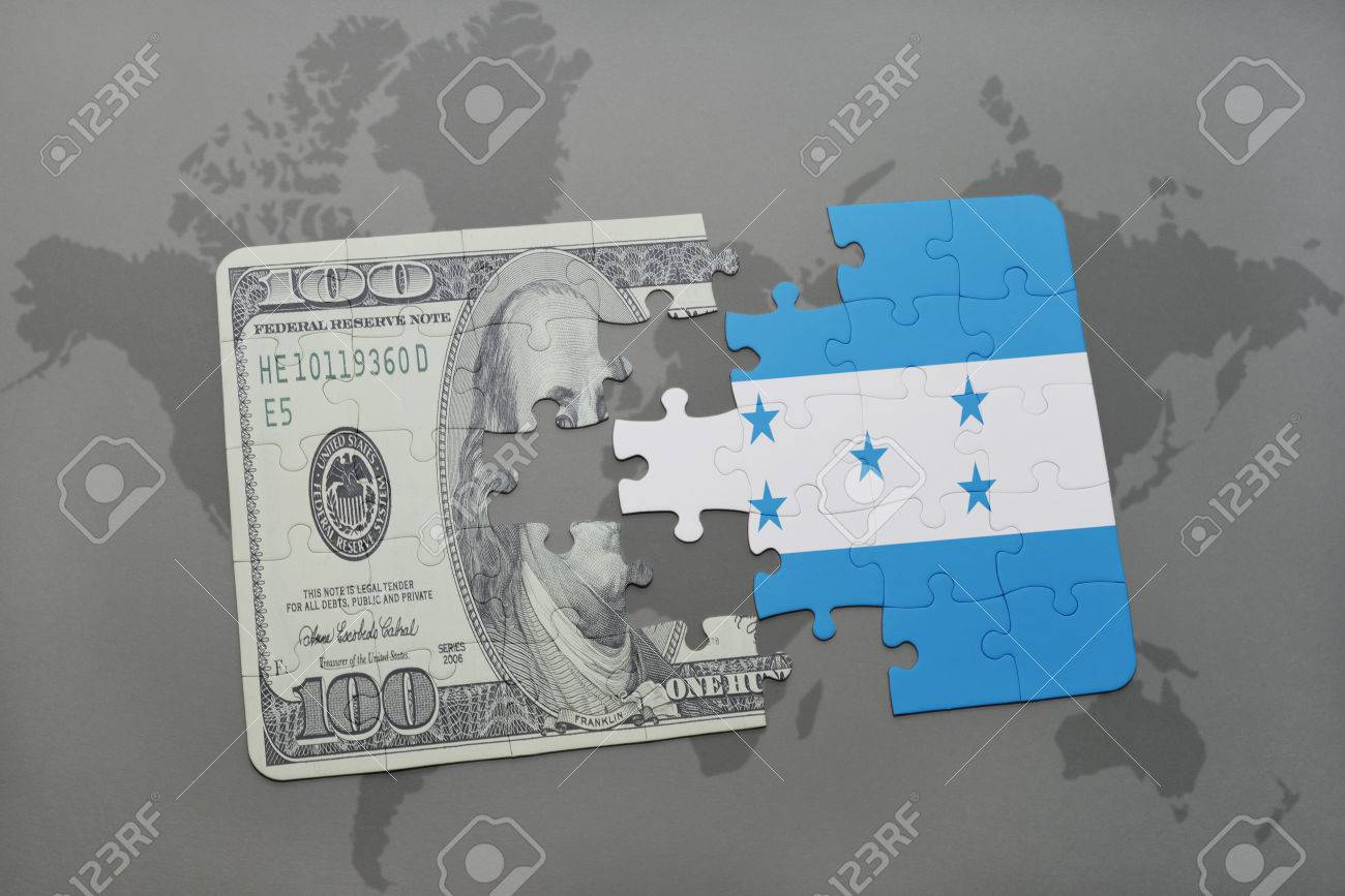 Puzzle with the national flag of honduras and dollar banknote on a puzzle with the national flag of honduras and dollar banknote on a world map background gumiabroncs Images
