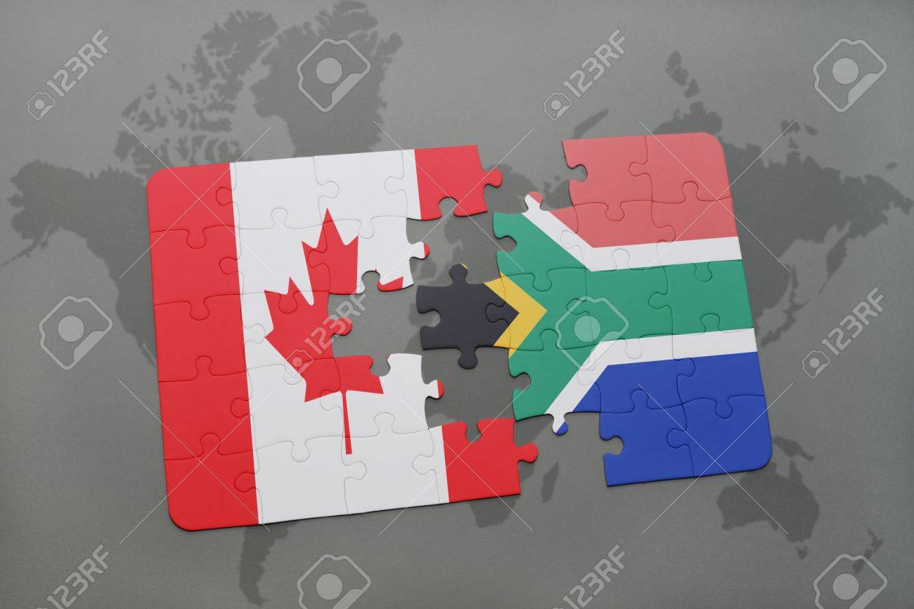 Puzzle with the national flag of canada and south africa on a puzzle with the national flag of canada and south africa on a world map background gumiabroncs Images