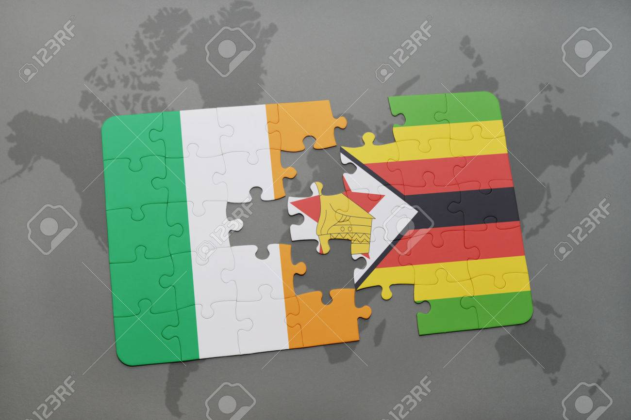 Puzzle With The National Flag Of Ireland And Zimbabwe On A World ...
