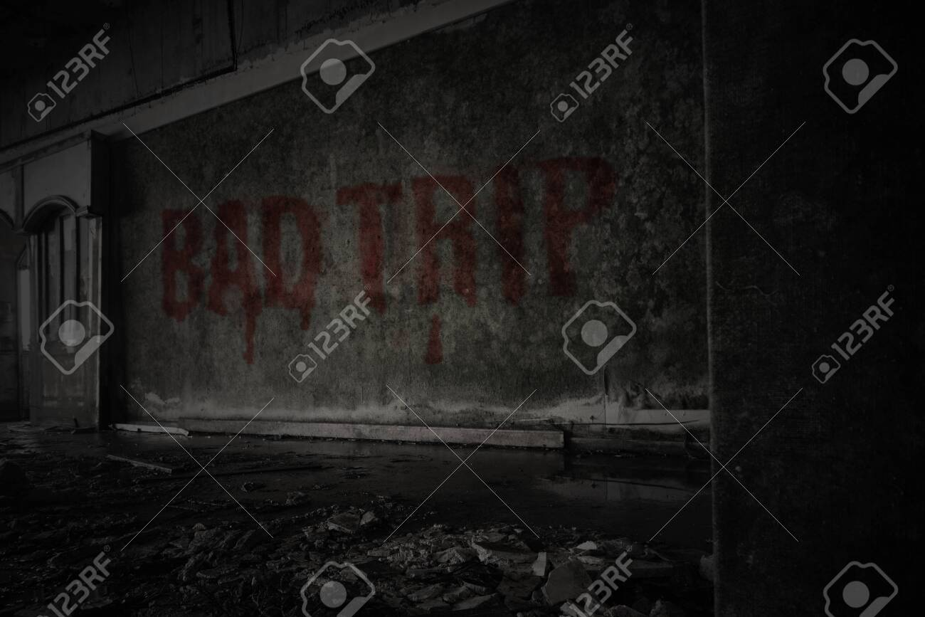 text bad trip on the dirty old wall in an abandoned ruined house - 123140678