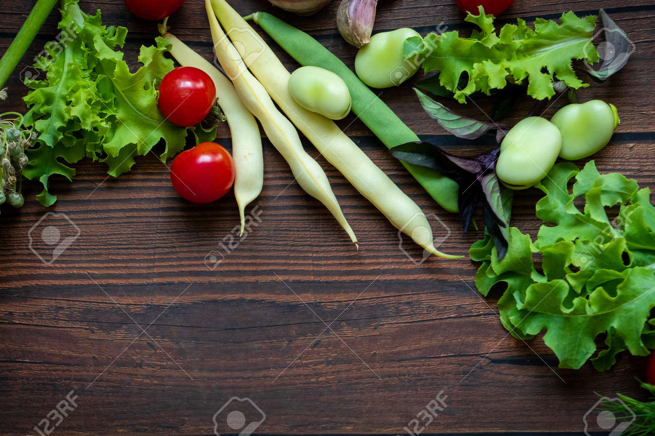 Autumn fresh vegetables on wooden table background - 153288878