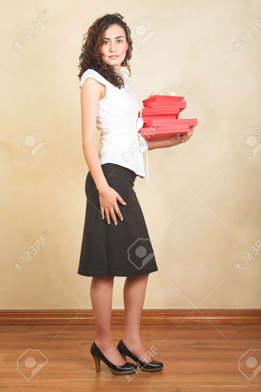 Young Businesswoman In White Shirt And Black Pencil Skirt Holding ...