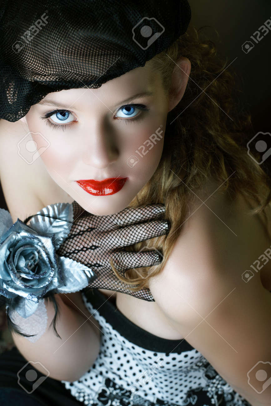 Beautiful blond woman in black net beret and gloves with silver faux rose on her hand, red lips and natural eyes Stock Photo - 3146123