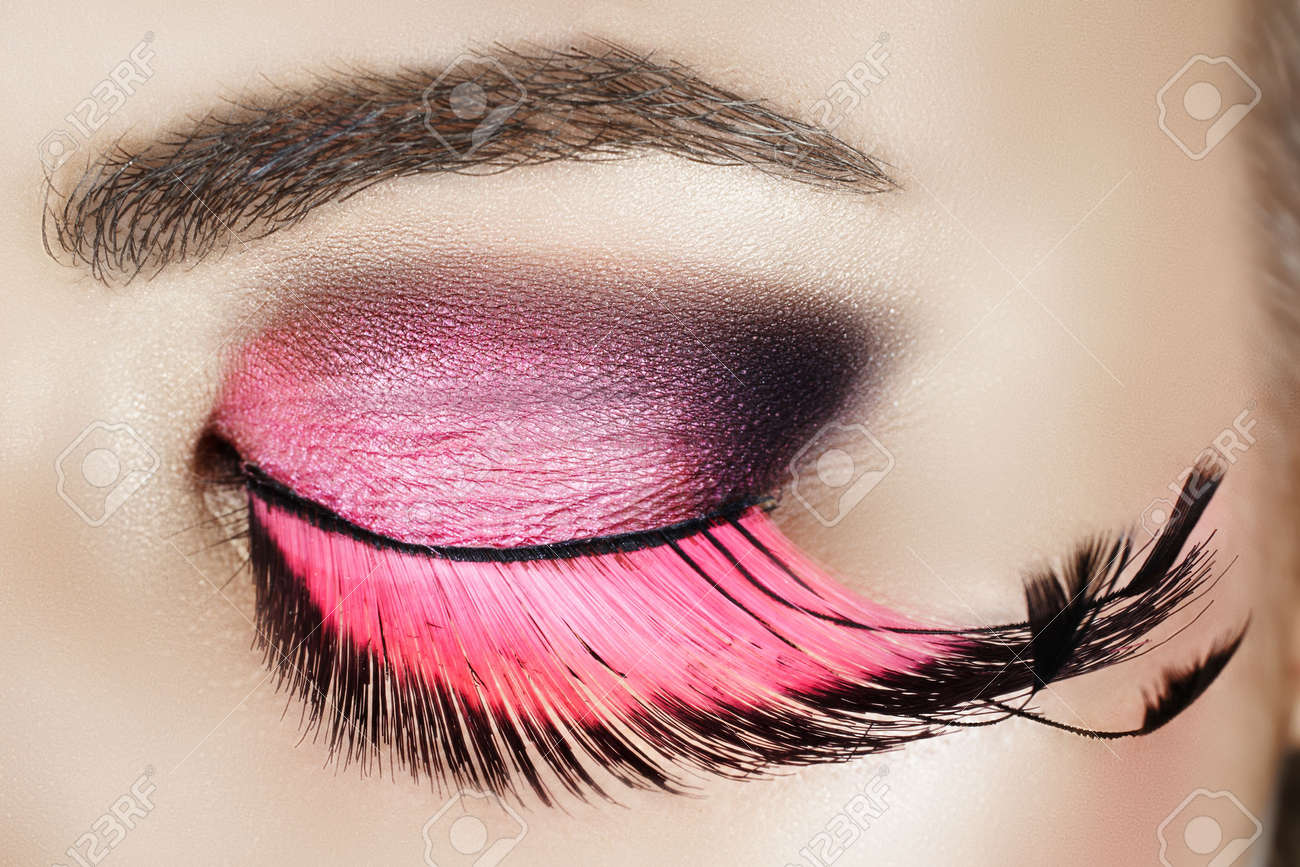 443c05ad258 Macro eye of a woman with pink smoky eyeshadow with long feather false  eyelashes Stock Photo