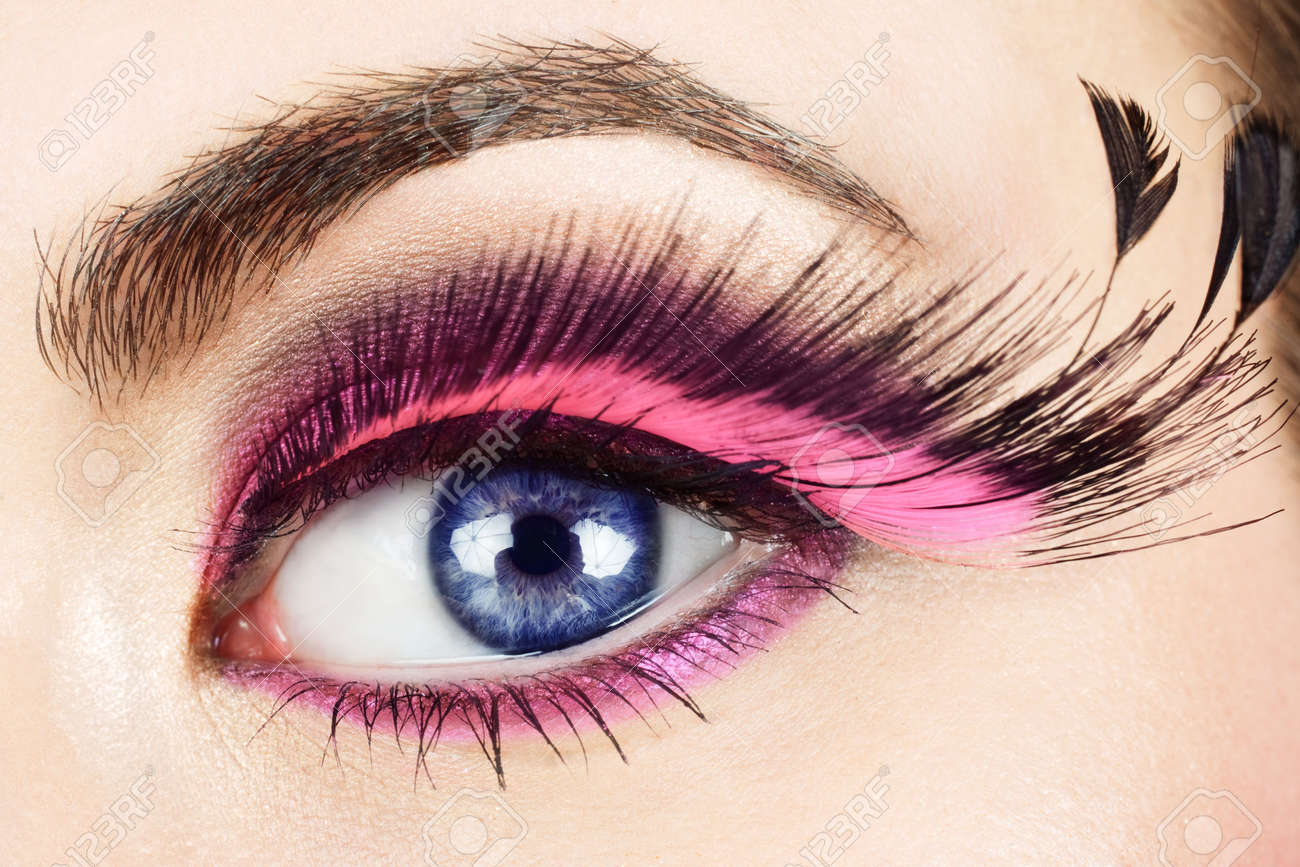 1a63791dc94 Macro of woman's eye with long pink feather fake eyelashes. Stock Photo -  4871916