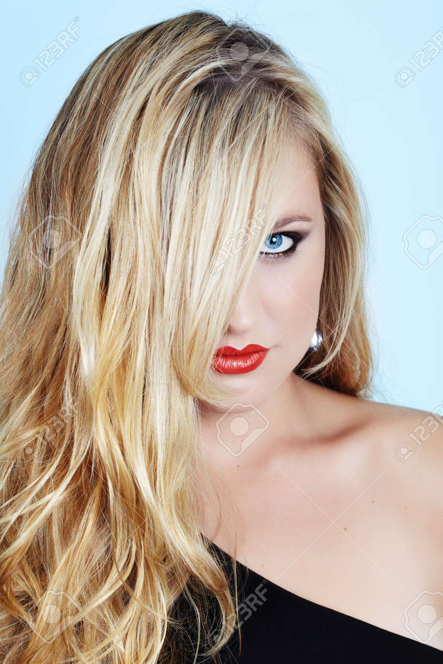 beautiful blond young woman with red lipstick and blue eyes and long loose hair Stock Photo - 5135404