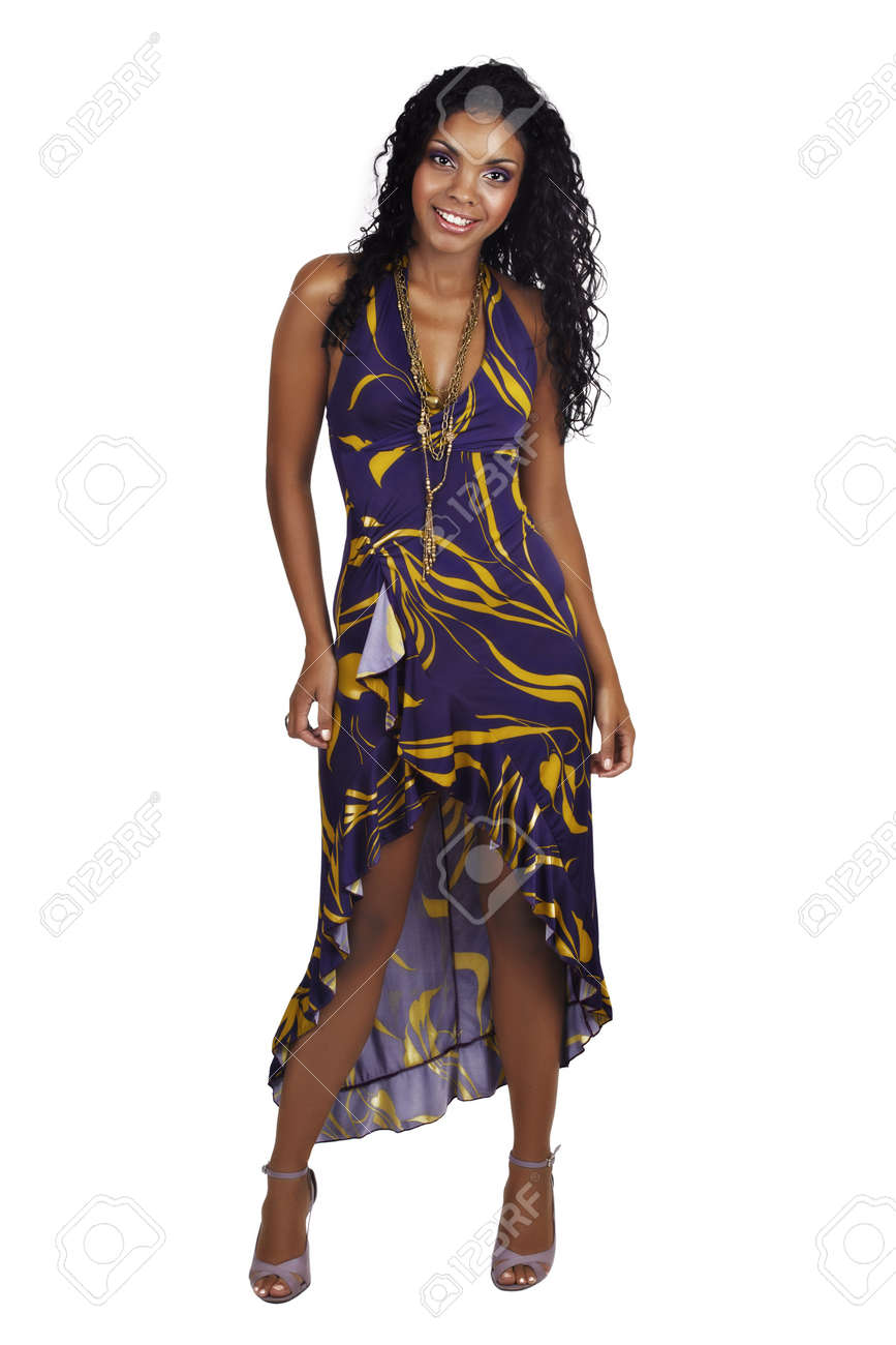 Beautiful African woman with long curly hair in purple halter neck dress and purple make-up. Stock Photo - 6985352