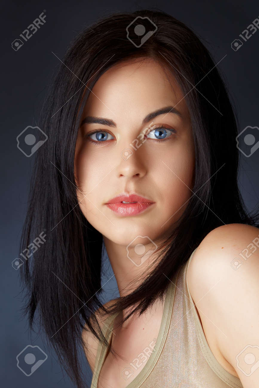 Structured Bob Hairstyles Beautiful Young Woman With Blue Eyes And Dark Hair In Structured