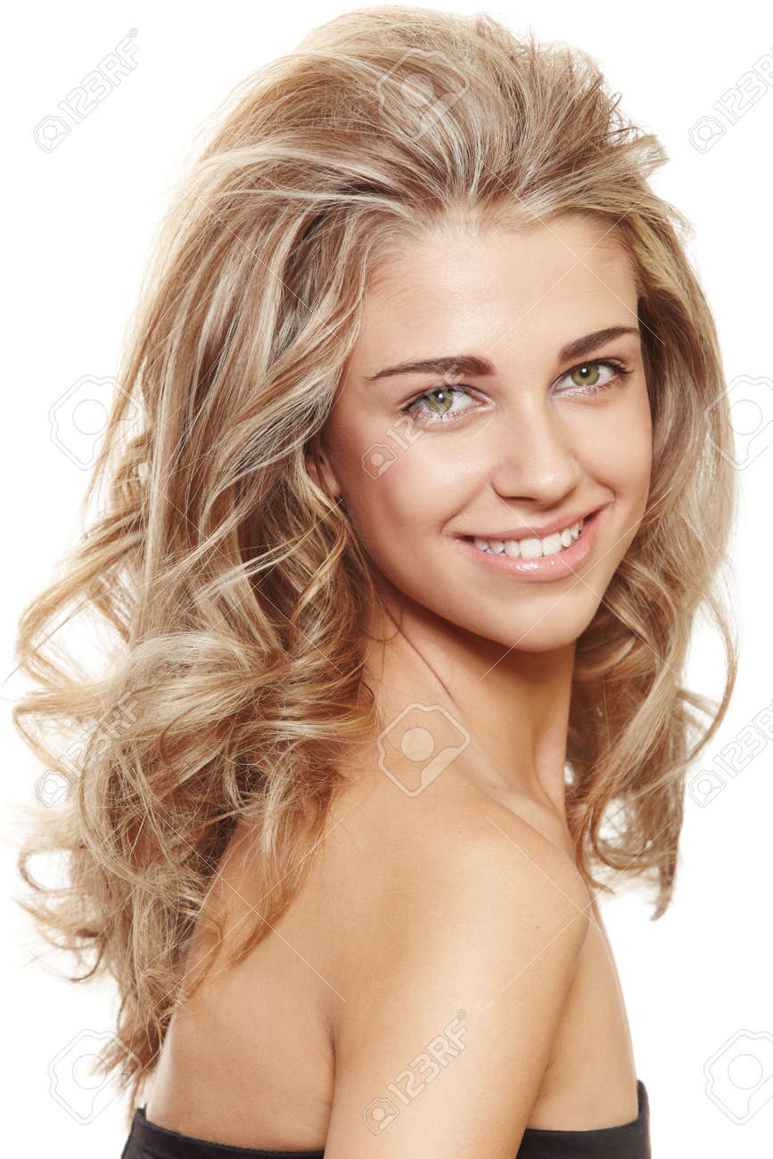 beautiful natural make-up woman with blond long hair in big hairstyle smiling at camera isolated on white Stock Photo - 9156637