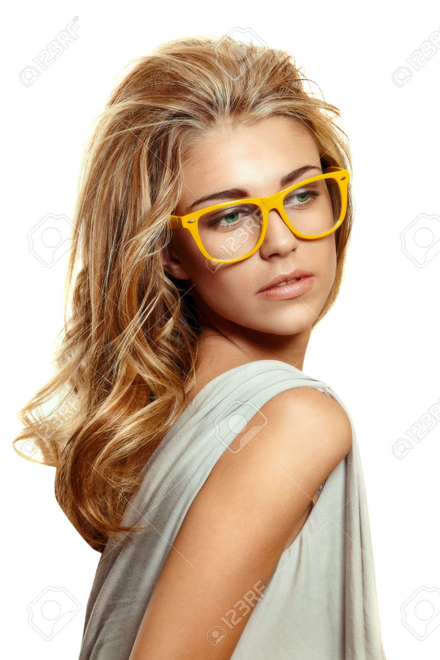 stock photo beautiful young woman with big blond long hair wearing yellow acetate frame glasses on white background