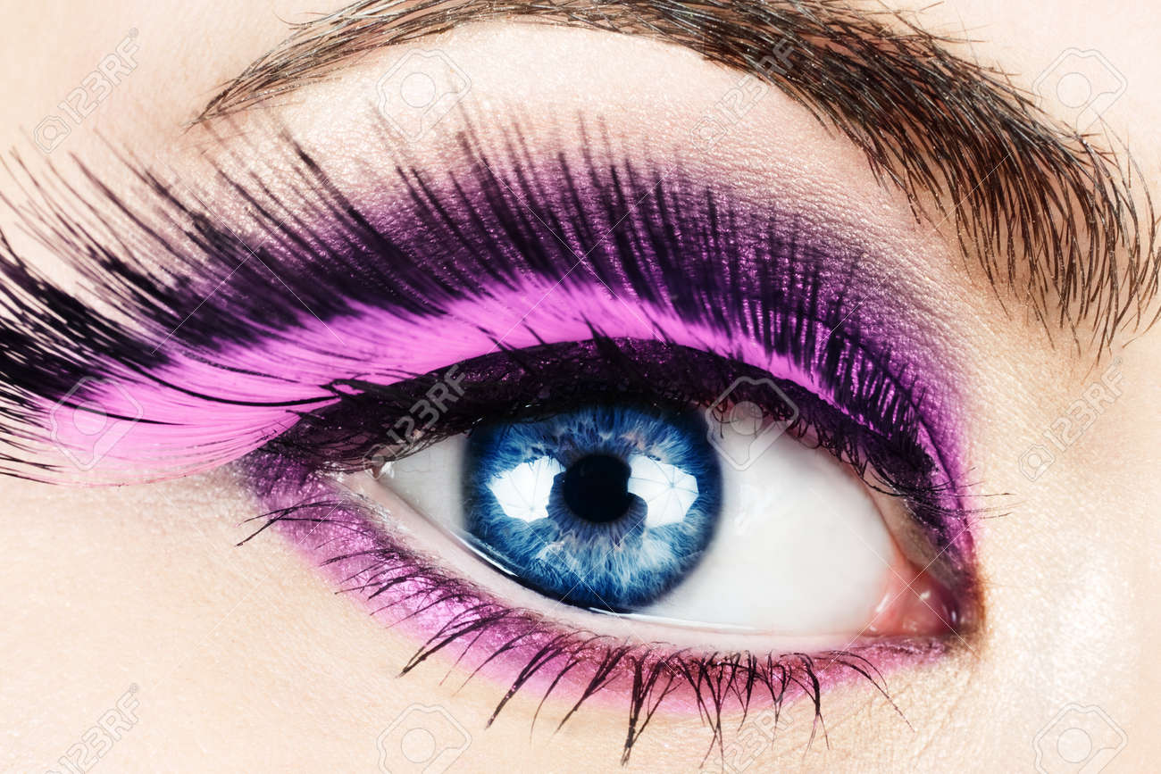 78c2106c184 Macro of woman's eye with long pink feather fake eyelashes. Stock Photo -  9594728