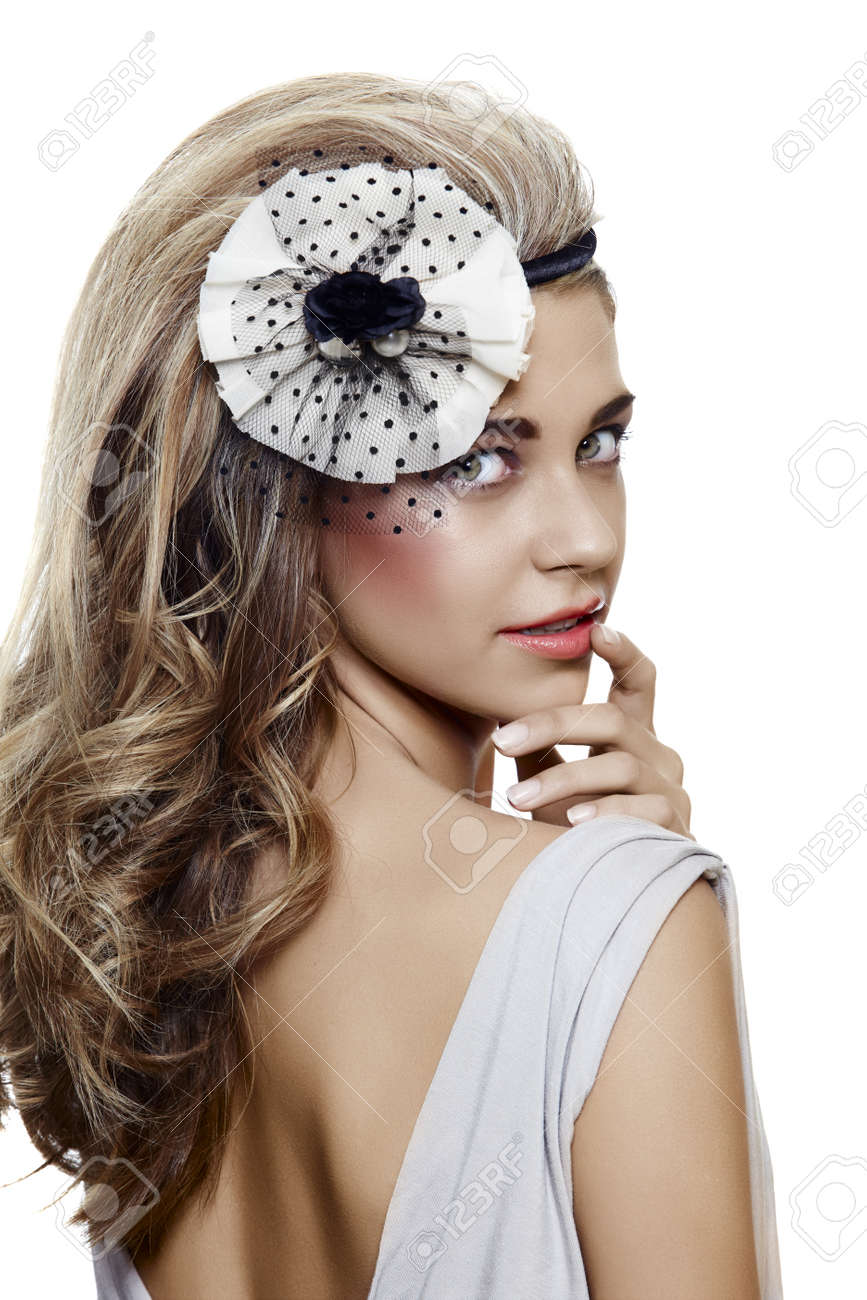 beautiful bride with long blond hair looking over her shoulder with a fresh smile and wearing vintage flower hair accessories Stock Photo - 9735751