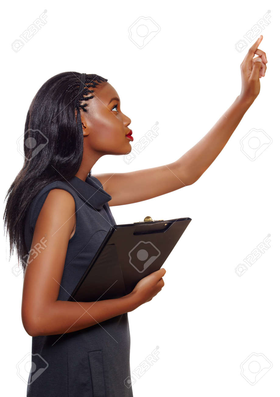 Portrait of an African American business woman pointing up while holding a folder during presentation on white background Stock Photo - 10012158