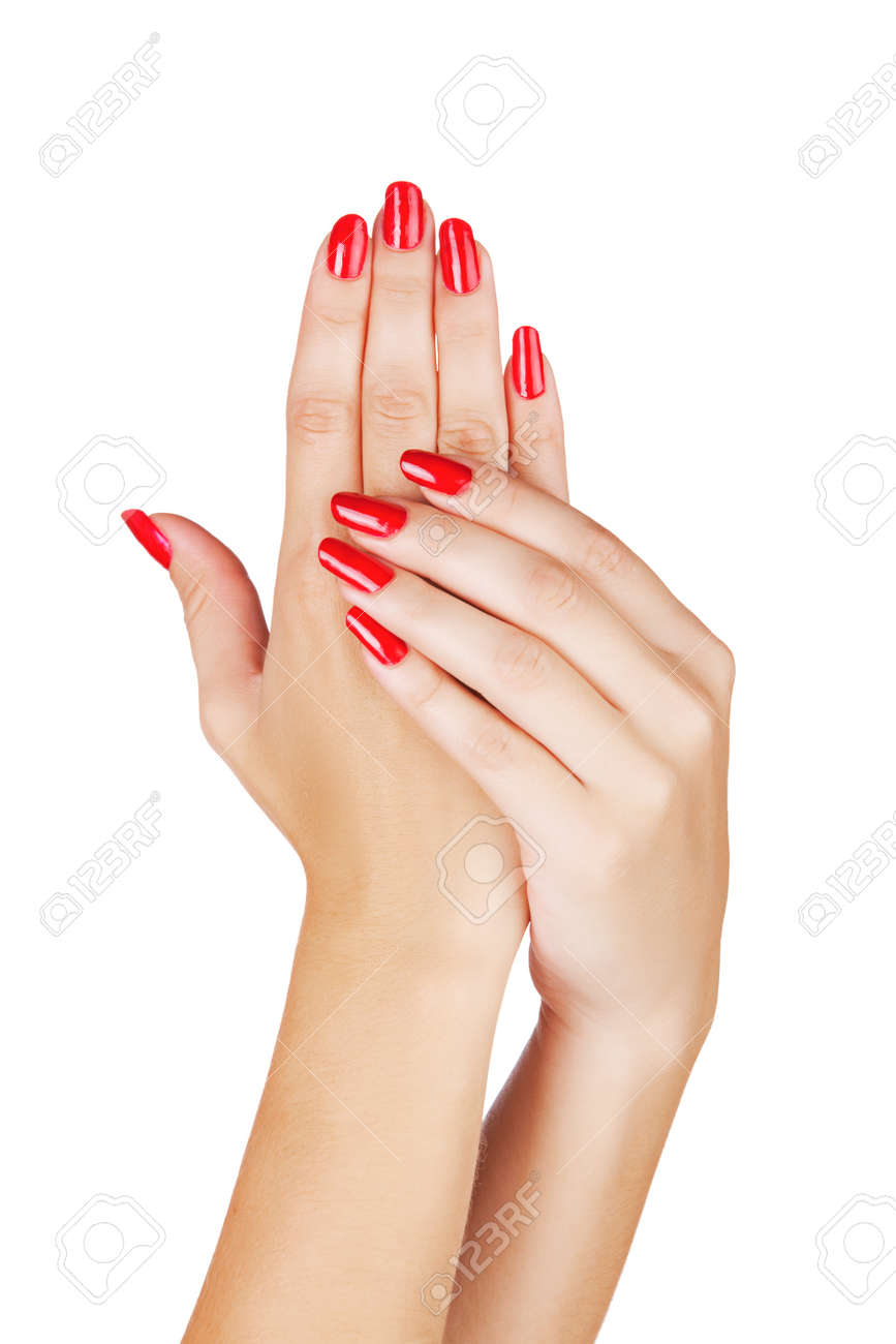 closeup of hands of a young woman with long red manicure on nails against white background Stock Photo - 13819909