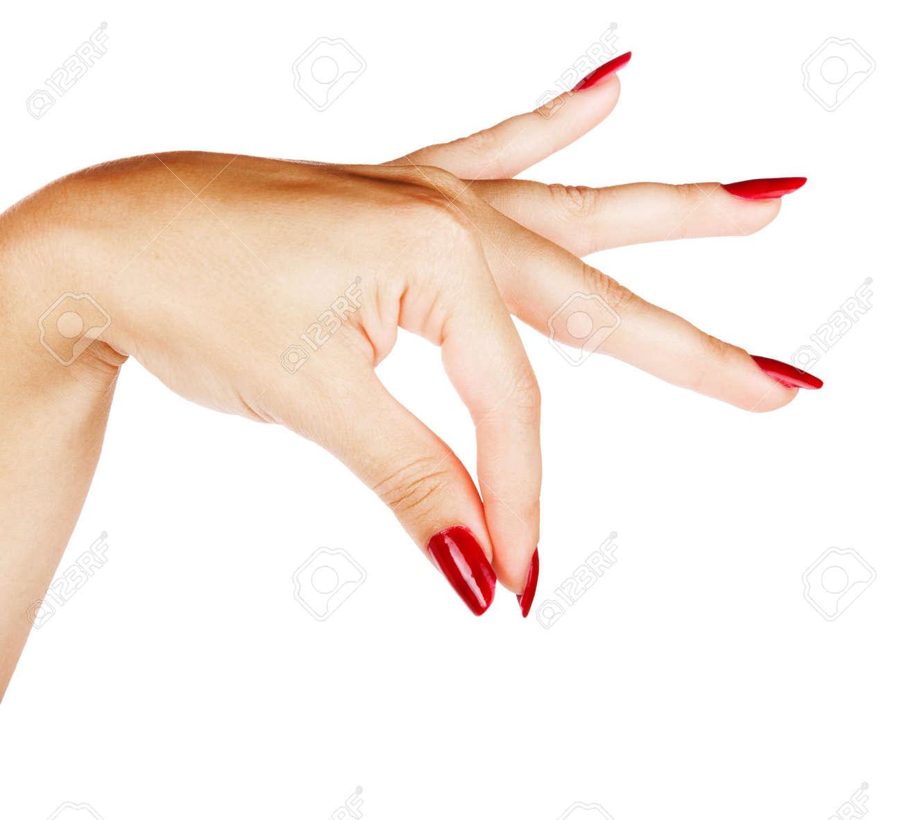 belle main d'une jeune femme avec manucure rouge avec attisé les doigts comme si vous teniez quelque chose sur le fond blanc Banque d'images - 13819835