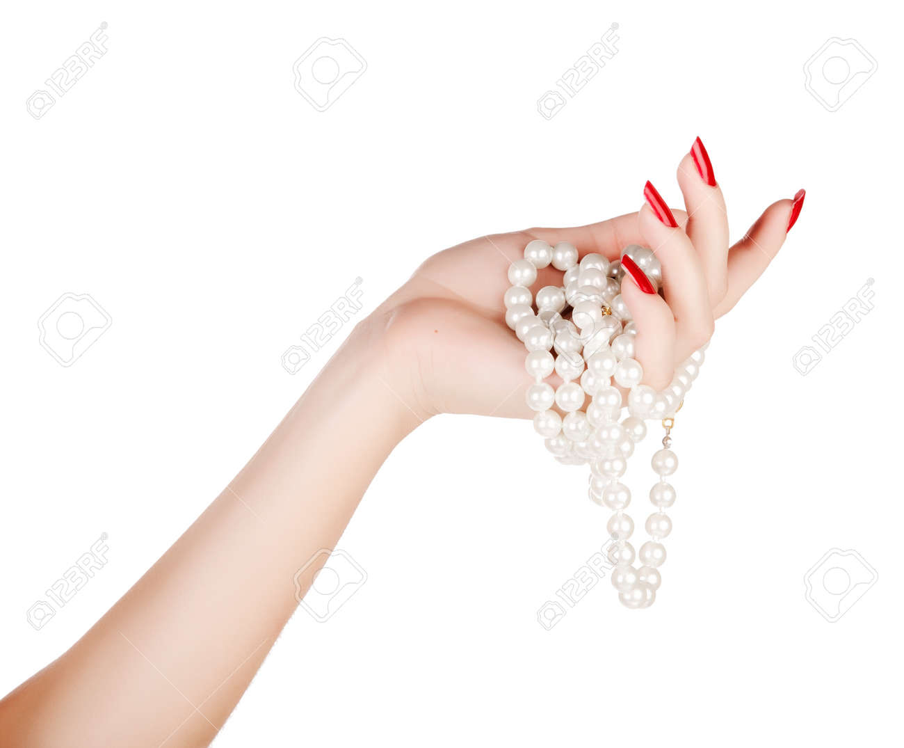Stock Photo  Beautiful Hand Of A Young Woman With Red Manicure Holding  White Pearl Necklace On White Background