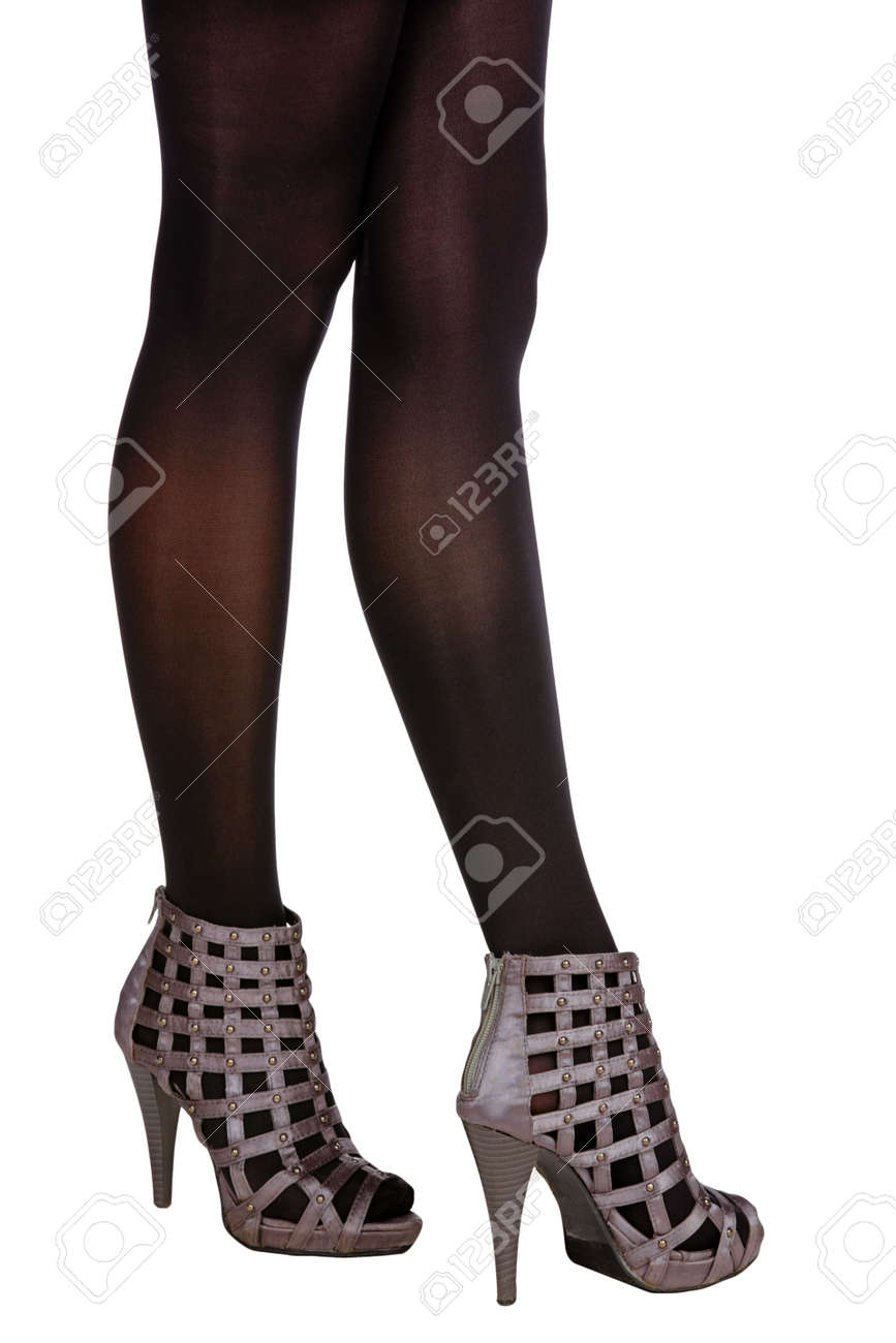 4c3d01f97ed woman with long legs in black stockings wearing satin gladiator sandals on high  heel Stock Photo