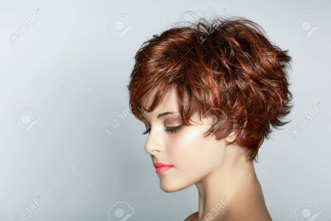 beautiful young woman with short brown haircut wears pink lipstick on studio background with copy space Stock Photo - 14683832