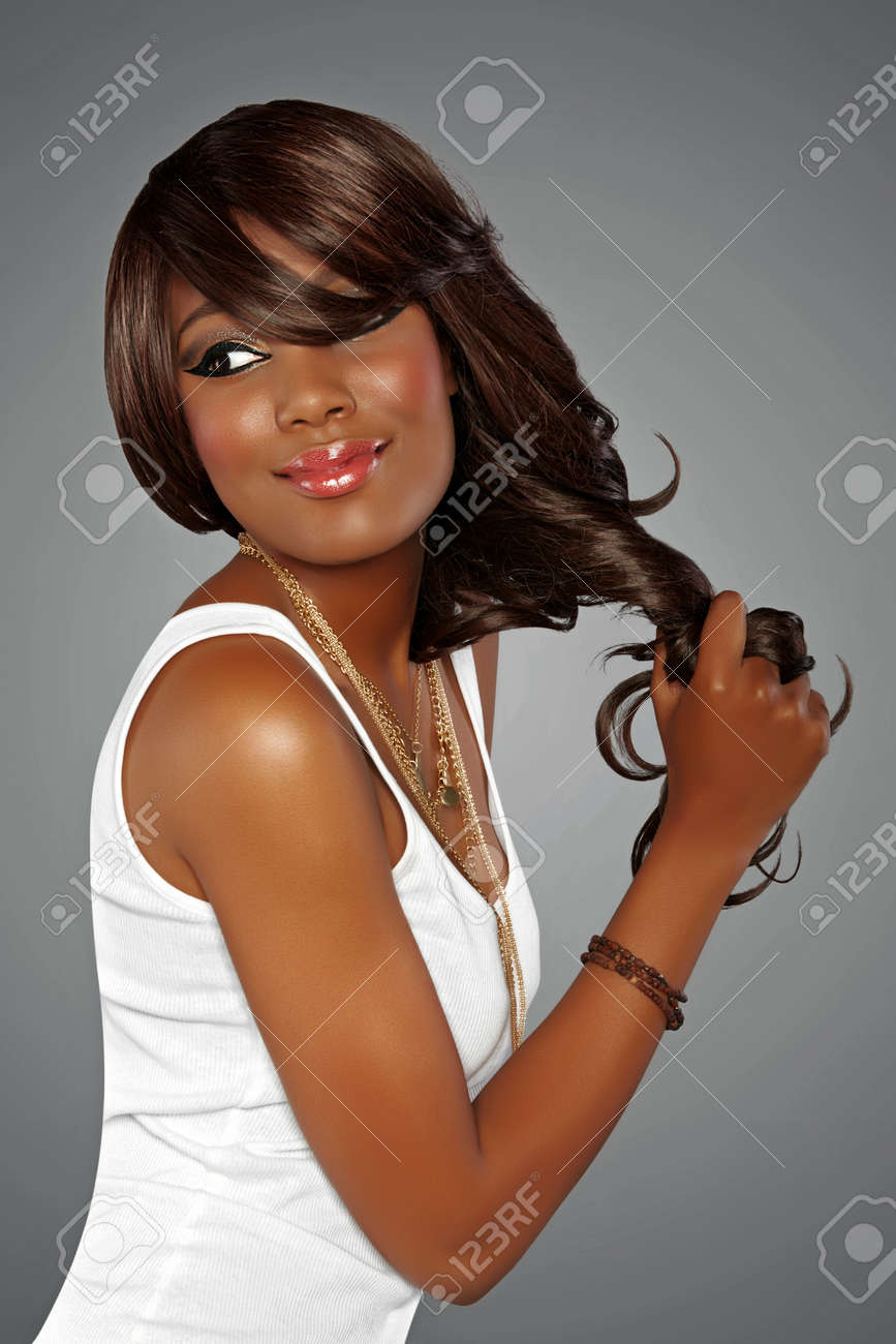 beautiful young african woman with long hair on studio background Stock Photo - 14683808