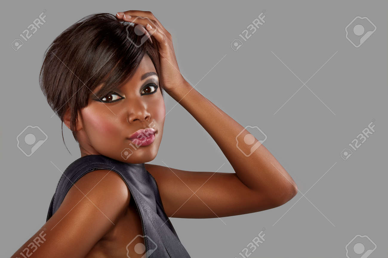 beautiful young african woman with long hair on studio background Stock Photo - 14683807