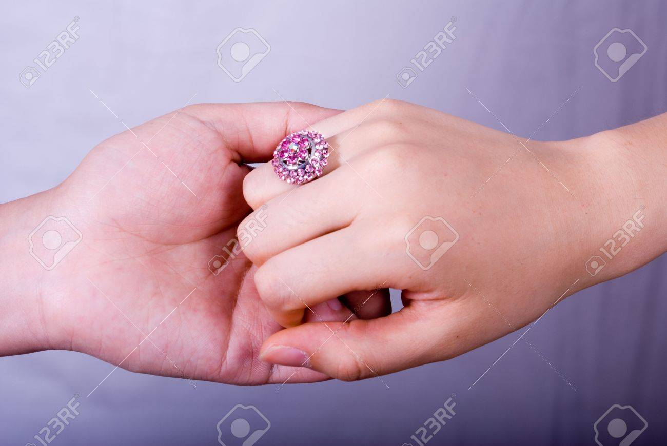 Hand In Hand With A Big Purple Diamond Ring. Stock Photo, Picture ...