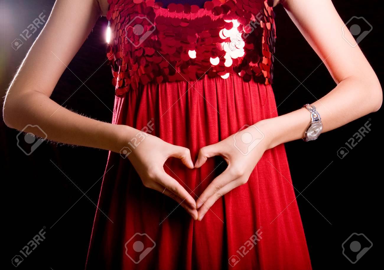 slim finger gesture on fresh red skirt - 3772990