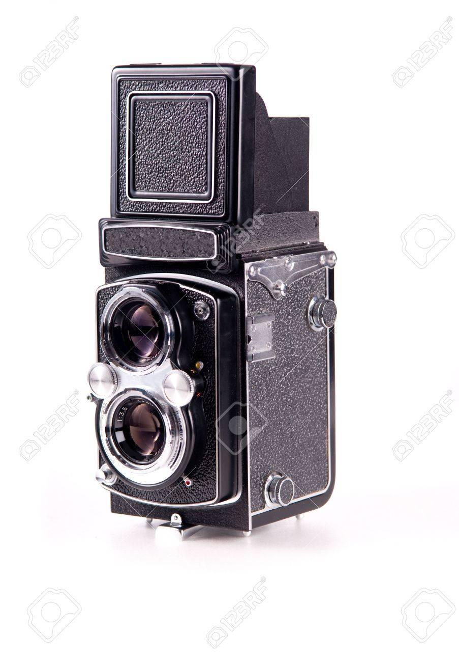 Antique medium format film mechanical camera isolated on white - 5578893