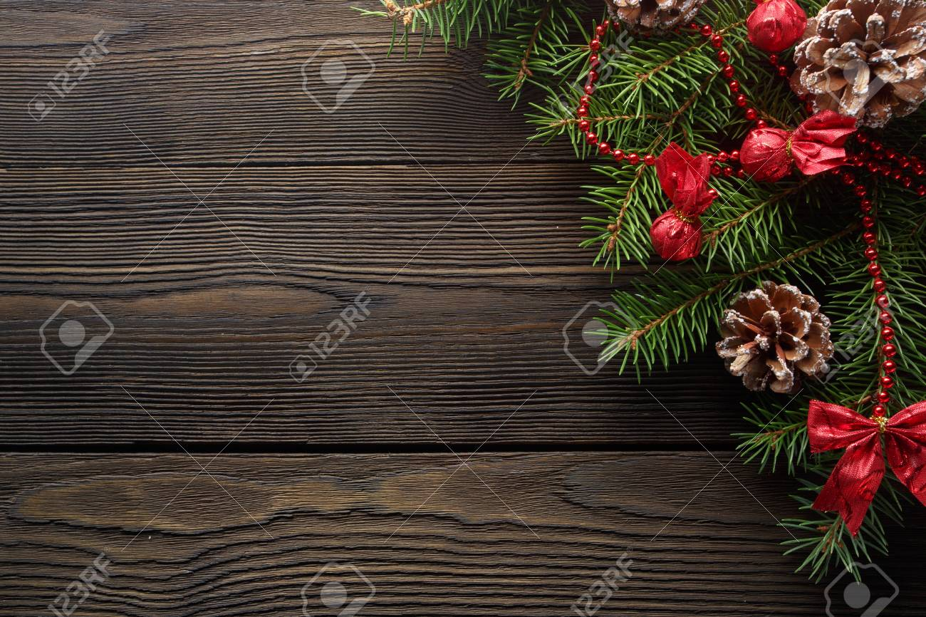 Christmas wooden background with Christmas tree and red decorations. Christmas Wreath with Rustic Wood Background. Christmas design - Merry Christmas. Christmas ornaments - 68504083