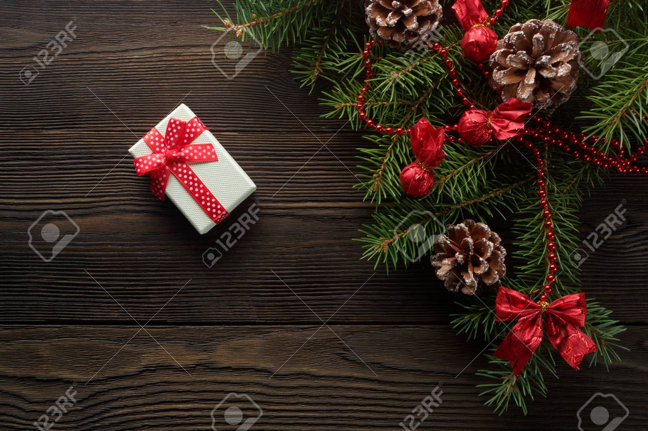 Christmas Wooden Background With Christmas Tree And Red Decoration