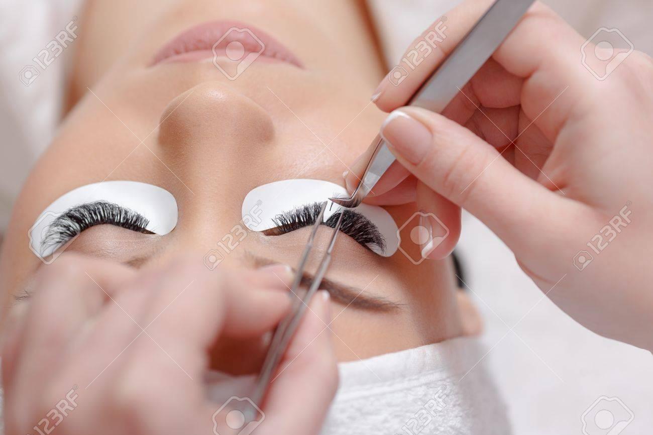 Permanent Makeup. Eyelash Extension Procedure. Woman Eye With ...